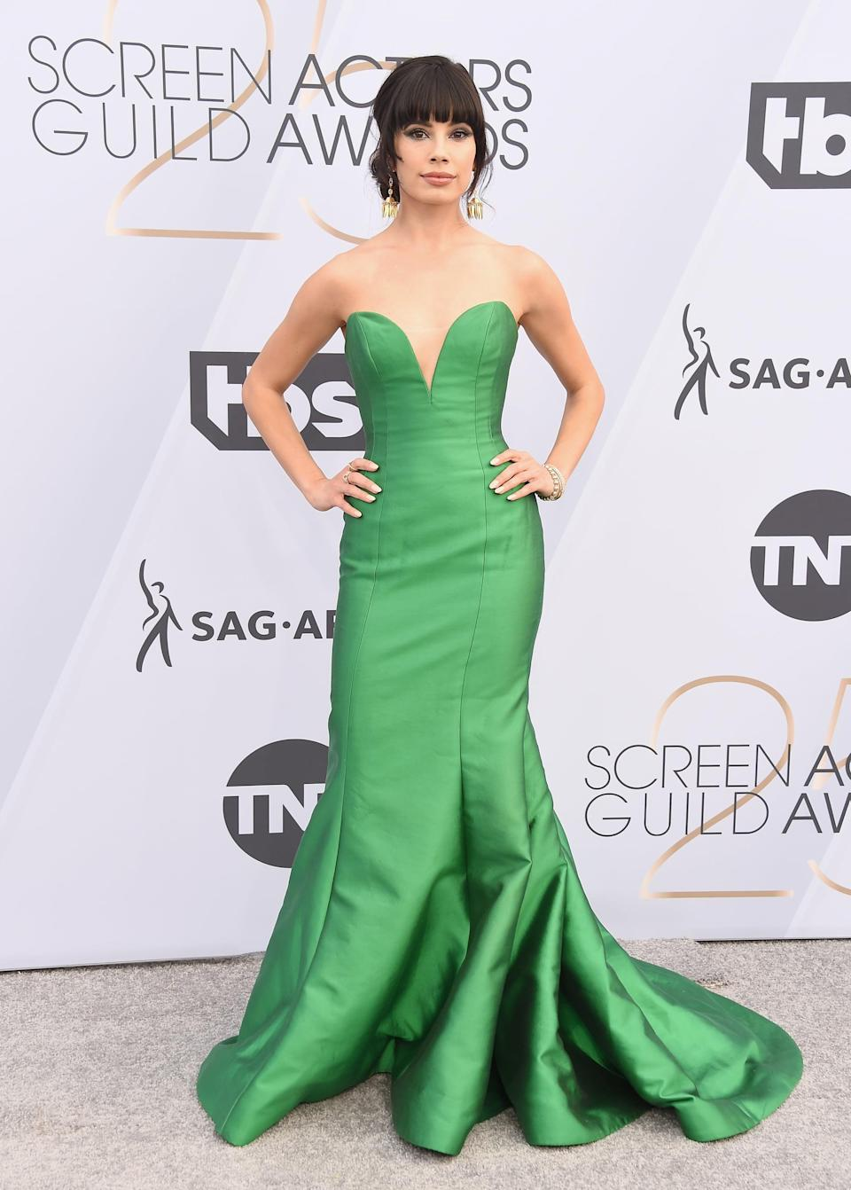 <p>Wearing a green mermaid gown and Hearts On Fire jewels.</p>