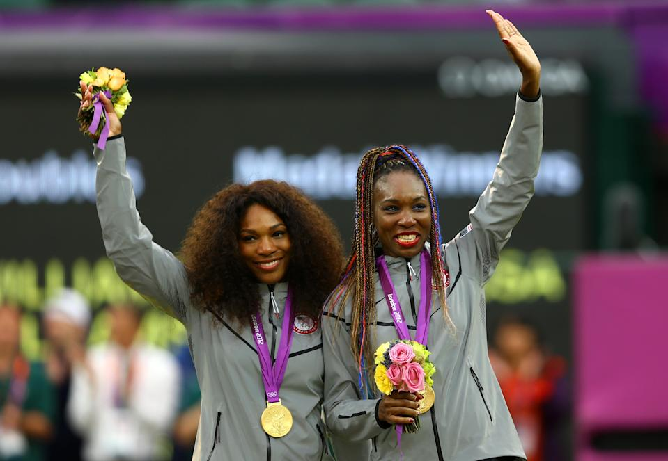 Gold medalists Serena Williams of the United States and Venus Williams of the United States celebrate on the podium during the medal ceremony for the Women's Doubles Tennis on Day 9 of the London 2012 Olympic Games at the All England Lawn Tennis and Croquet Club on August 5, 2012 in London, England. (Photo by Paul Gilham/Getty Images)