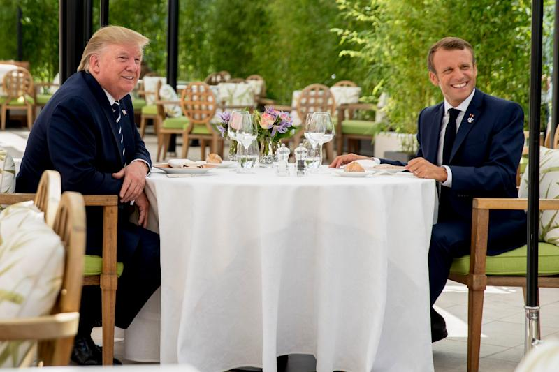 President Donald Trump sits for lunch with French President Emmanuel Macron at the Hotel du Palais in Biarritz, southwest France. Efforts to salvage consensus among the Group of Seven rich democracies on the economy, trade and environment were fraying around the edges even as leaders were arriving before their three-day summit.