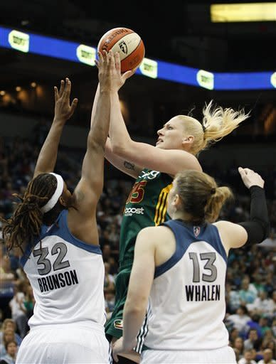 Seattle Storm forward Lauren Jackson (15) goes up for a shot against Minnesota Lynx forward Rebekkah Brunson (32) and guard Lindsay Whalen (13) during the second half of Game 1 of the WNBA basketball first-round playoff series Friday, Sept. 28, 2012, in Minneapolis. The Lynx won 78-70. (AP Photo/Stacy Bengs)