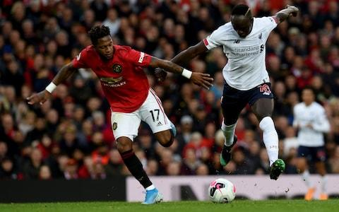 Fred challenges Sadio Mane during Manchester United's 1-1 draw with Liverpool - Credit: Getty Images