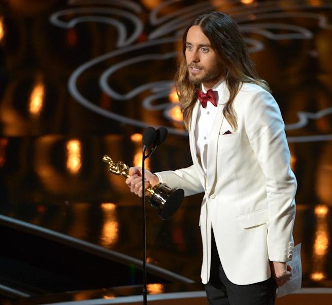 "Jared Leto accepts the award for best actor in a supporting role for ""Dallas Buyers Club"" during the Oscars at the Dolby Theatre on Sunday, March 2, 2014, in Los Angeles. (Photo by John Shearer/Invision/AP)"