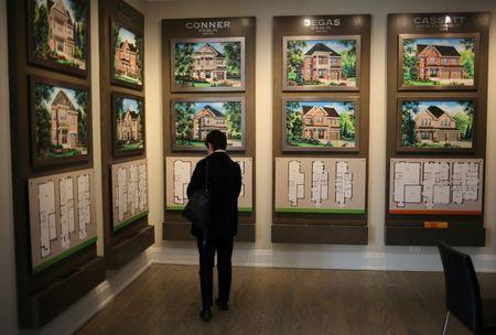 A woman views house designs at a showroom for Fieldgate Homes, one of three developers at the Impressions subdivision near the town of Kleinburg, Ontario, Canada May 13, 2017. REUTERS/Chris Helgren/Files