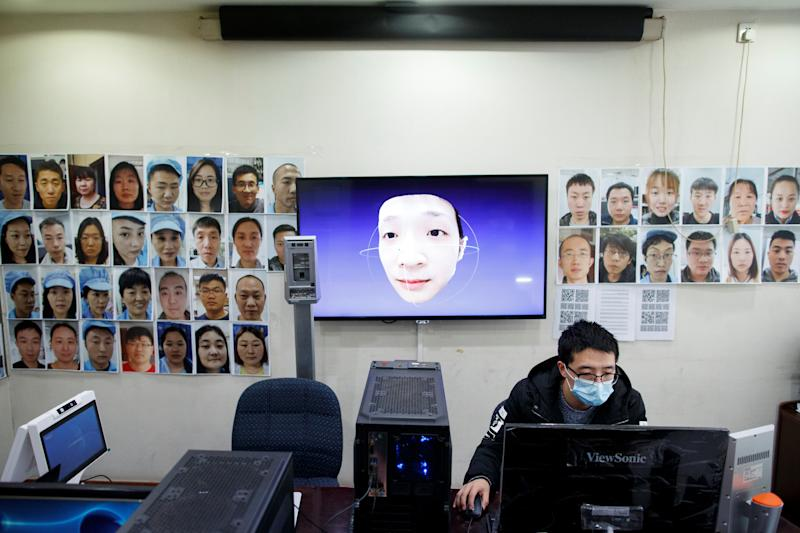 A software engineer works on a facial recognition program that identifies people when they wear a face mask at the development lab of the Chinese electronics manufacturer Hanwang (Hanvon) Technology in Beijing as the country is hit by an outbreak of the novel coronavirus (COVID-19), China, March 6, 2020. Picture taken March 6, 2020. REUTERS/Thomas Peter
