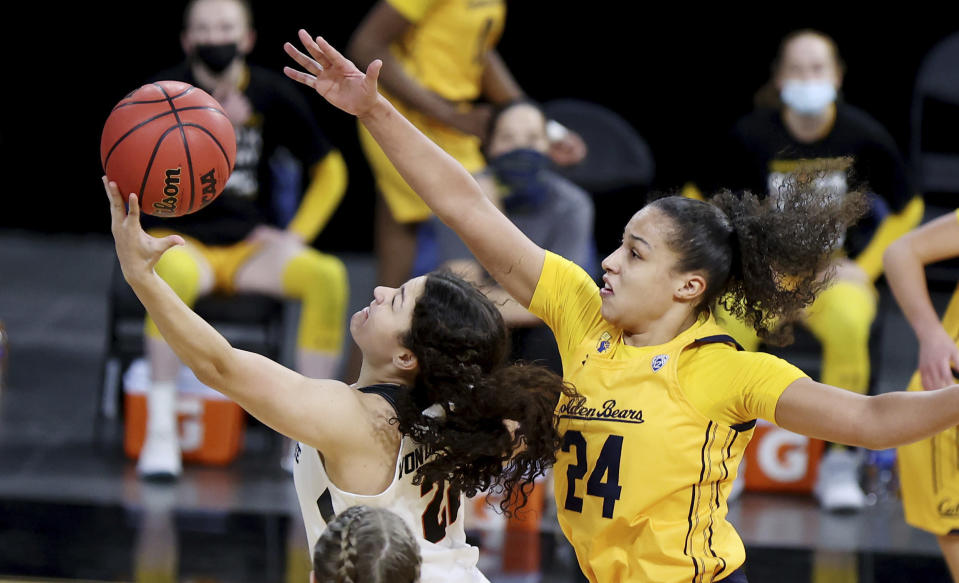 Oregon State guard Talia Von Oelhoffen (22) shoots as California forward Evelien Lutje Schipholt (24) defends during an NCAA college basketball game in the first round of the Pac-12 women's tournament Wednesday, March 3, 2021, in Las Vegas. (AP Photo/Isaac Brekken)