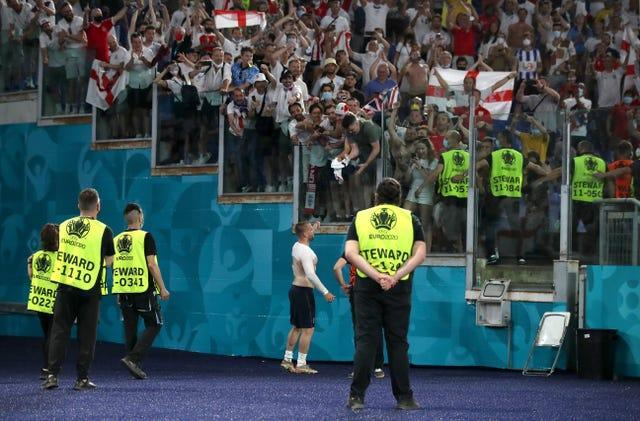 Luke Shaw gives his England shirt to a fan in the stands at the Stadio Olimpico