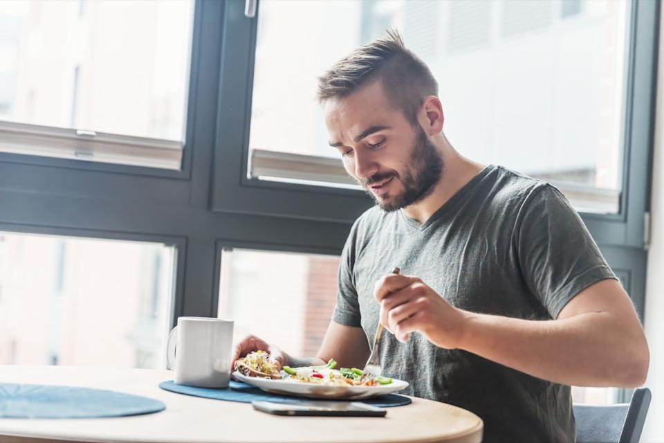 A man eating a healthy morning meal, breakfast at home