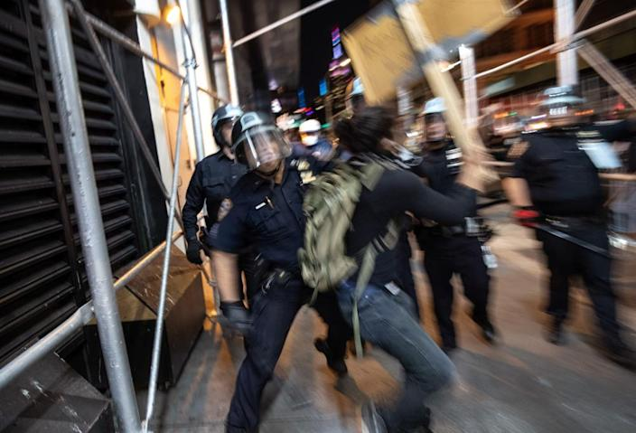 "<span class=""element-image__caption"">Protesters clash with New York City police in Manhattan on 31 May.</span> <span class=""element-image__credit"">Photograph: John Moore/Getty Images</span>"