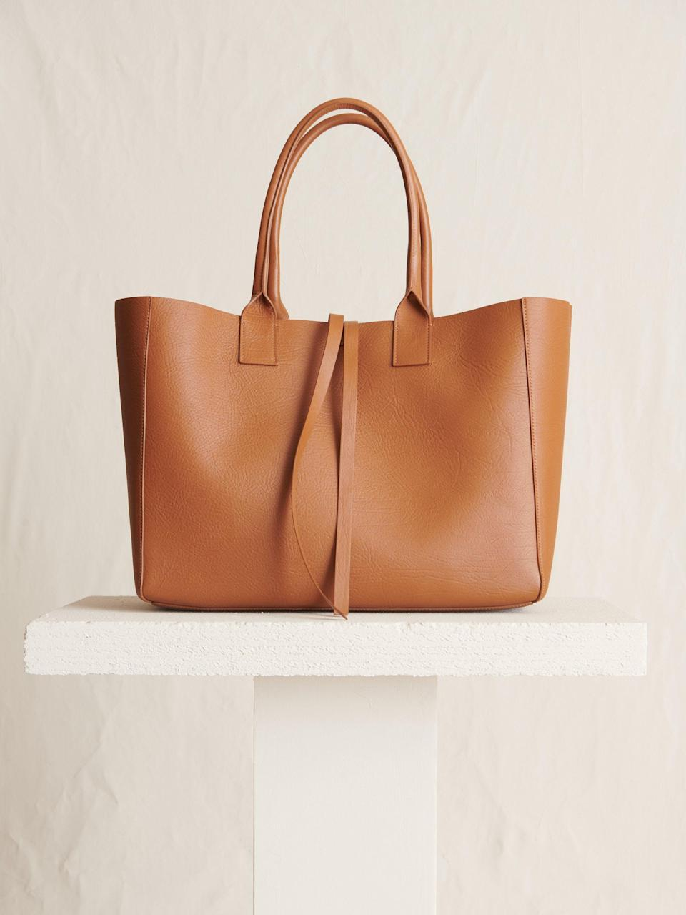 """<p><strong>Yvonne Koné</strong></p><p>yvonnekone.com</p><p><strong>$5600.00</strong></p><p><a href=""""https://www.yvonnekone.com/collections/totes/products/large-filippo-bag-ambra"""" rel=""""nofollow noopener"""" target=""""_blank"""" data-ylk=""""slk:Shop Now"""" class=""""link rapid-noclick-resp"""">Shop Now</a></p><p>The Danish label fuses sleek design with influence teased from the Ivory Coast. Fashioned from Italian leather, this minimalist shape stands as a versatile, failsafe option for toting necessities and more. </p>"""