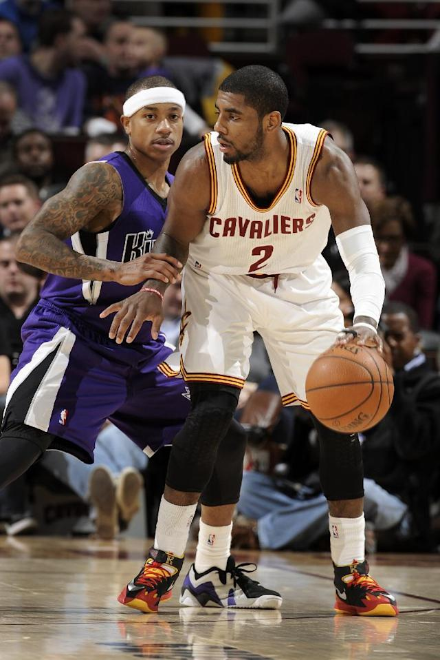 CLEVELAND, OH - FEBRUARY 11: Kyrie Irving #2 of the Cleveland Cavaliers controls the ball against Isaiah Thomas #22 of the Sacramento Kings at The Quicken Loans Arena on February 11, 2014 in Cleveland, Ohio. (Photo by David Liam Kyle/NBAE via Getty Images)