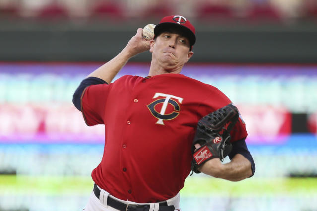 Minnesota Twins pitcher Kyle Gibson throws to a Kansas City Royals batter during the first inning of a baseball game Thursday, Sept. 19, 2019, in Minneapolis. (AP Photo/Jim Mone)