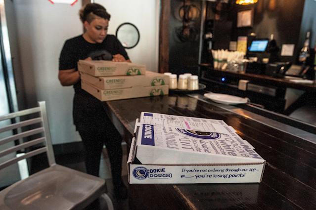 Employees at Pi Pizzeria received an anonymous gift of Insomnia Cookies from someone hoping to show support. (Joseph Rushmore for HuffPost)