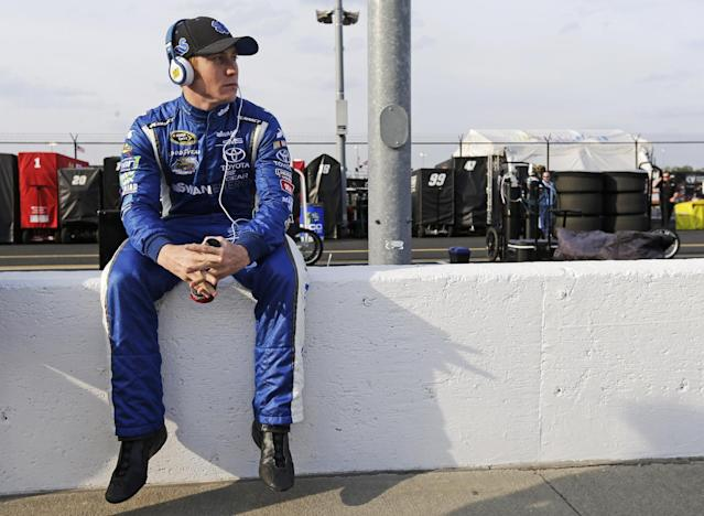 Cole Whitt sits on the pit-road wall as he waits on qualifications for a NASCAR Sprint Cup auto race at Darlington Speedway in Darlington, S.C., Friday, April 11, 2014. (AP Photo/Chuck Burton)