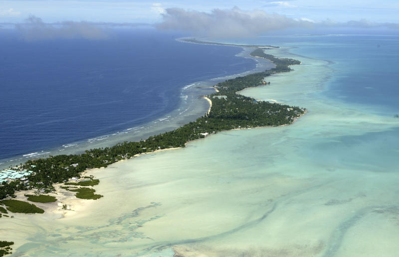 FILE - In this March 30, 2004 file photo, Tarawa atoll, Kiribati, is seen in an aerial view. Fearing that climate change could wipe out their entire Pacific archipelago, the leaders of Kiribati are considering an unusual backup plan: moving the populace to Fiji. Kiribati President Anote Tong told The Associated Press on Friday, March 9, 2012 that his Cabinet this week endorsed a plan to buy nearly 6,000 acres on Fiji's main island, Viti Levu. He said the fertile land, being sold by a church group for about $9.6 million, could provide an insurance policy for Kiribati's entire population of 103,000, though he hopes it will never be necessary for everyone to leave. (AP Photo/Richard Vogel, File)