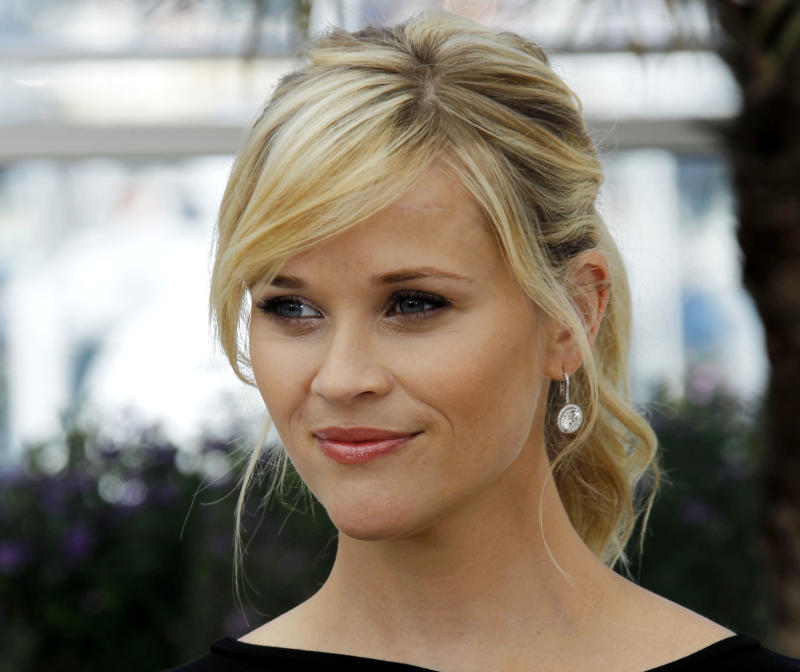 """FILE - This May 26, 2012 file photo shows actress Reese Witherspoon posing during a photo call for """"Mud"""" at the 65th international film festival, in Cannes, southern France. The 36-year-old Oscar winner and mother of three will receive the March of Dimes Grace Kelly Award at its Celebration of Babies luncheon Friday Dec. 7, 2012 at the Beverly Hills Hotel.  (AP Photo/Joel Ryan, file)"""
