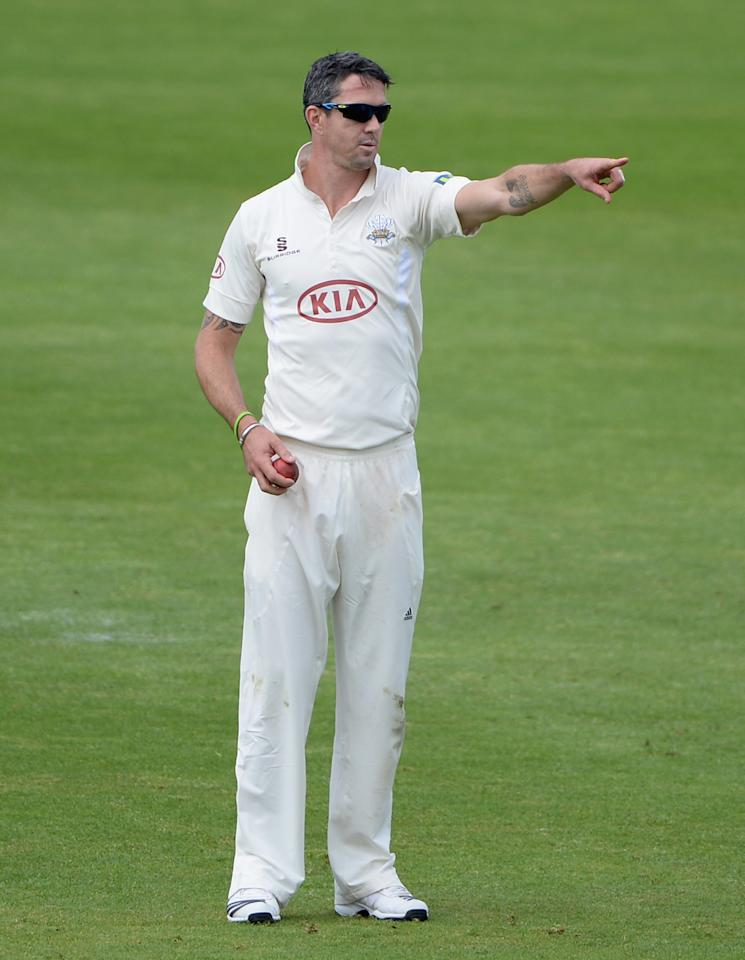 LEEDS, ENGLAND - JUNE 21:  Kevin Pietersen of Surrey points at his field during day one of the LV County Championship Division One match between Yorkshire and Surrey at Headingley on June 21, 2013 in Leeds, England.  (Photo by Gareth Copley/Getty Images)