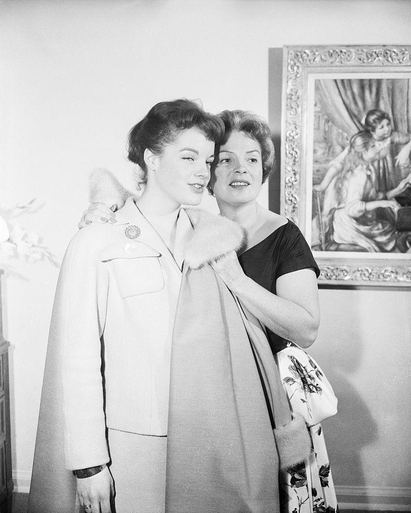 <p>To keep everyone's jackets safe, it was the job of the host to take the guest's coat and place it in a coat closet or a spare room. No draping your own coat over the arm of a chair!</p>