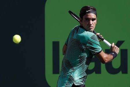 Mar 27, 2017; Miami, FL, USA; Roger Federer of Switzerland hits a backhand against Juan Martin del Potro of Argentina (not pictured) on day seven of the 2017 Miami Open at Crandon Park Tennis Center. Federer won 6-3, 6-4. Mandatory Credit: Geoff Burke-USA TODAY Sports
