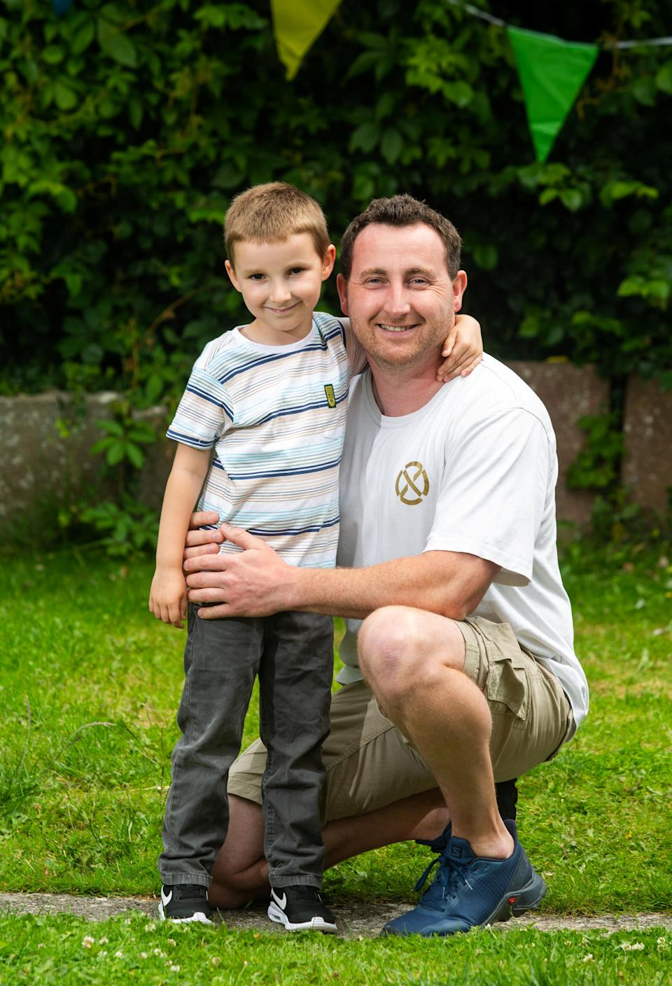 Ollie Hall and his dad, Chris. (SWNS)