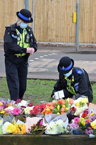 PHOTO: Community police officers lay flowers to the tributes in the village of Marston Moretaine, north of London on Feb. 3, 2021, home of the late Captain Tom Moore following his death on Feb. 2. (Justin Tallis/AFP via Getty Images)