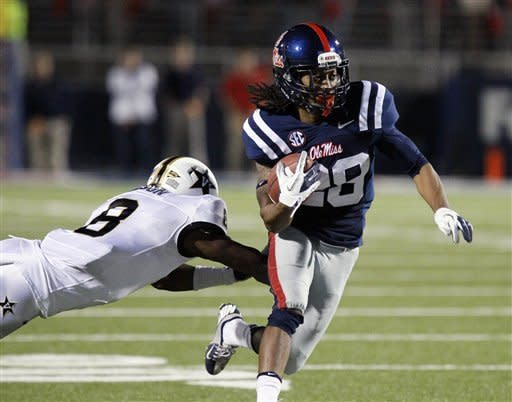 Mississippi wide receiver Korvic Neat (28) rushes past Vanderbilt defensive back Trey Wilson (8) with a pass reception for a first down in the second quarter of an NCAA college football game in Oxford, Miss., Saturday, Nov. 10, 2012. (AP Photo/Rogelio V. Solis)