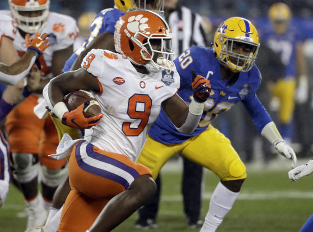 FILE - In this Dec. 1, 2018, file photo, Clemson's Travis Etienne (9) runs past Pittsburgh's Dennis Briggs (20) during the first half of the Atlantic Coast Conference championship NCAA college football game in Charlotte, N.C. Clemson plays Notre Dame on Dec. 29 in in college football playoff semifinal in Arlington, Texas. Etienne has 1,463 yards on 176 rushes (8.3 per carry) and 21 of Clemsons 46 touchdowns on the ground. (AP Photo/Chuck Burton, File)