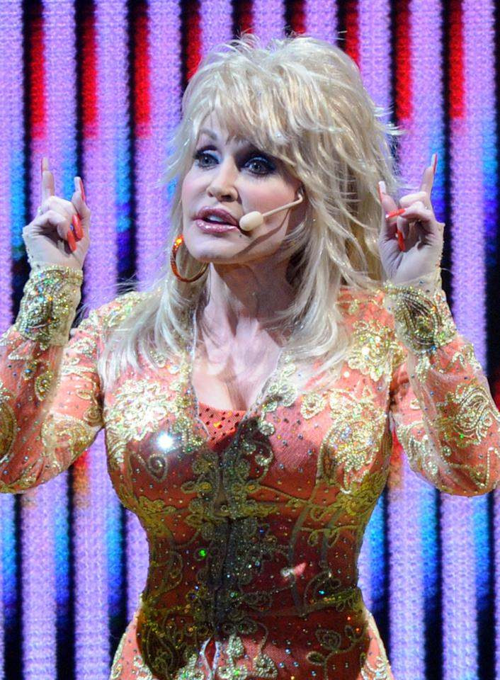 "Dolly Parton<br><br>Age: 65<br><br>Earning power: Known as ""The Queen of Country Music"", Parton is estimated to be worth $225 million. <br><br>(Photo by Rick Diamond/Getty Images)"