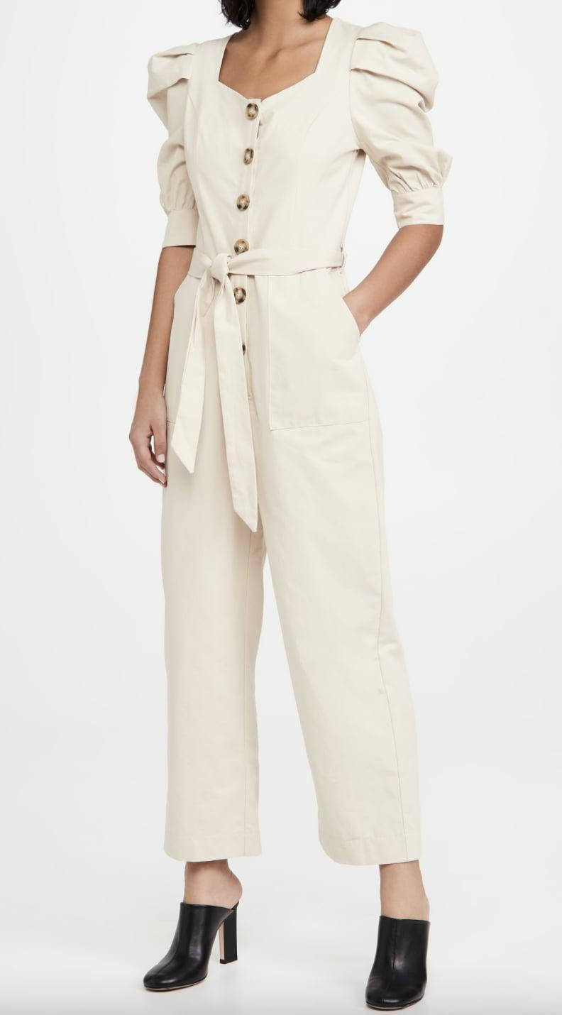 <p>This <span>En Saison Cotton Poplin Jumpsuit with Puff Sleeves</span> ($110) will go well with your favorite mules or barely-there heels.</p>