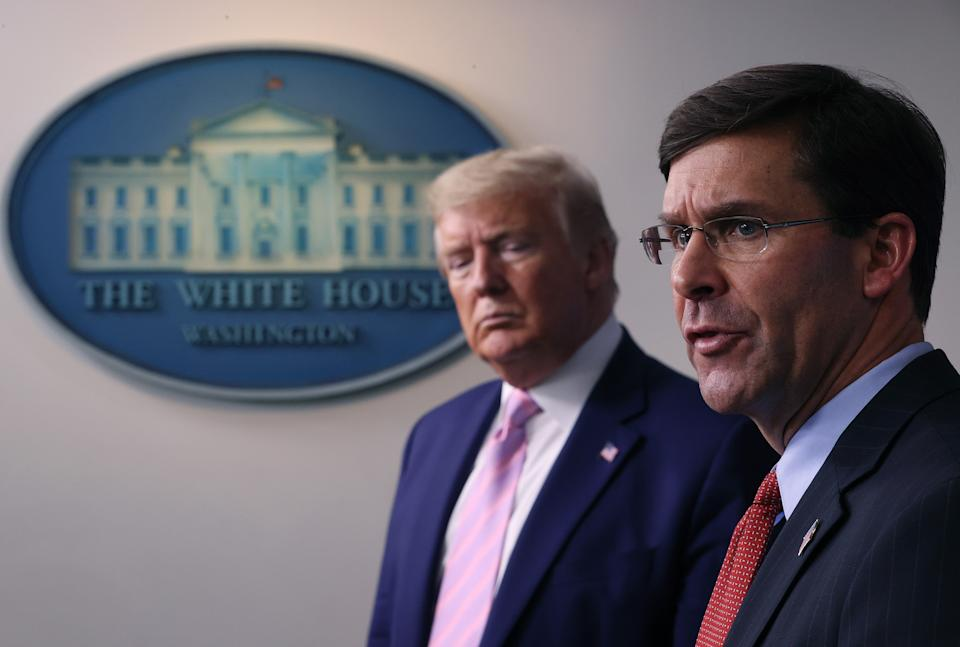 WASHINGTON, DC - APRIL 01: Secretary of Defense Mark Esper speaks as U.S. President Donald Trump listens during the daily White House coronavirus press briefing April 1, 2020 in Washington, DC. After announcing yesterday that COVID-19 could kill between 100,000 and 240,000 Americans, the Trump administration is also contending with the economic effects of the outbreak as the stock market continues to fall, businesses remain closed, and companies lay off and furlough employees. (Photo by Win McNamee/Getty Images)