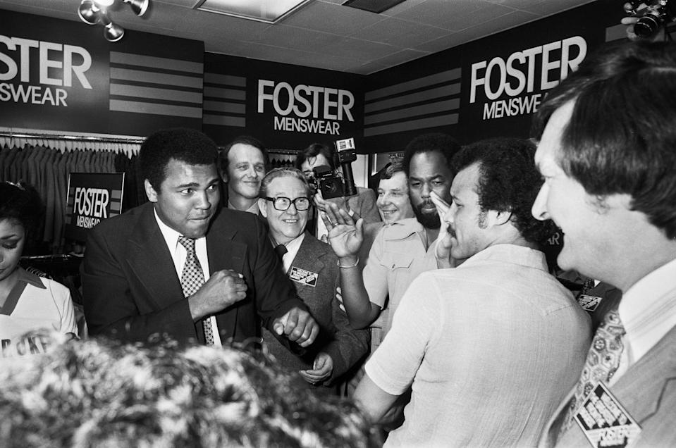 Muhammad Ali Visiting the Bull Ring Shopping Centre in Birmingham. Pictured here in Debenhams Department Store with John Conteh 7th June 1979. (Photo by Staff/Mirrorpix/Getty Images)