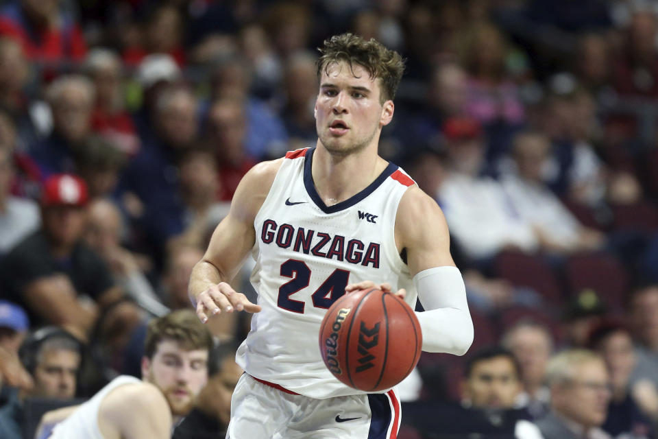 FILE - In this March 9, 2020, file photo, Gonzaga's Corey Kispert plays against San Francisco during the first half of an NCAA college basketball game in the West Coast Conference men's tournament in Las Vegas. Kispert has made The Associated Press 2020-21 preseason All-America team, announced Wednesday, Nov. 11. (AP Photo/Isaac Brekken, File)