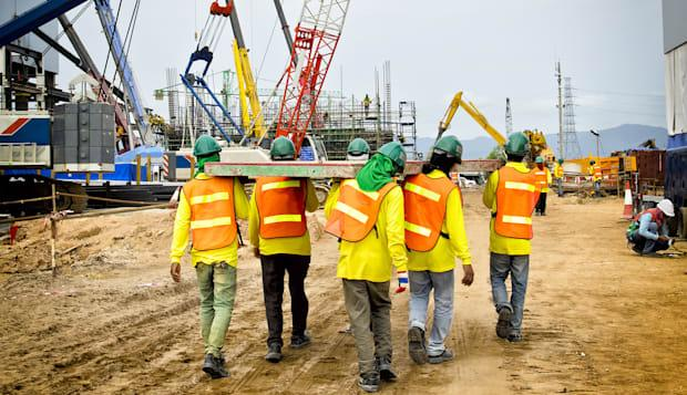 construction workers are...