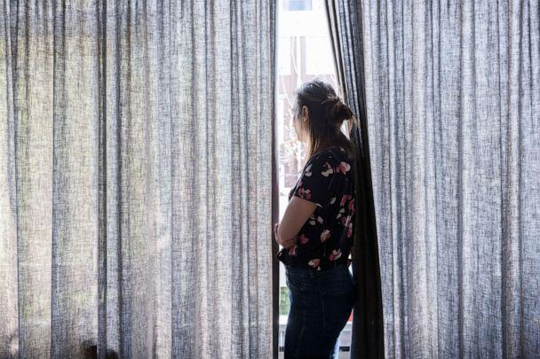 PHOTO: A woman looks out of a window in this stock photo. (STOCK PHOTO/Getty Images)