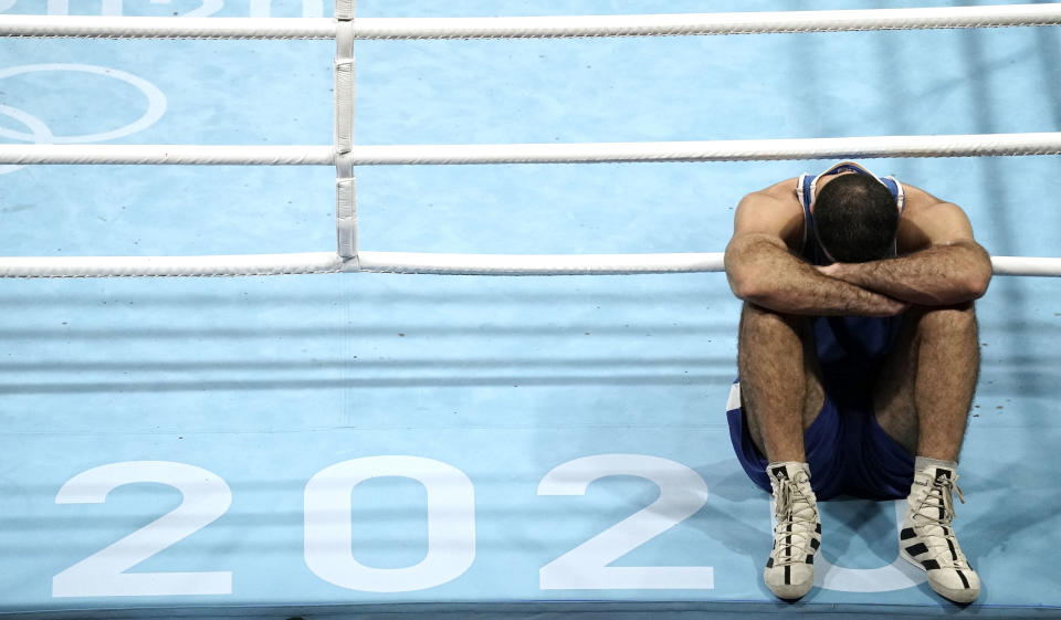 Aug 1, 2021; Tokyo, Japan; Mourad Aliev (FRA) refuses to leave the ring after being disqualified in his men's super heavy quarterfinal bout against Frazer Clarke (GBR) during the Tokyo 2020 Olympic Summer Games at Kokugikan Arena. Mandatory Credit: Andrew P. Scott-USA TODAY Sports