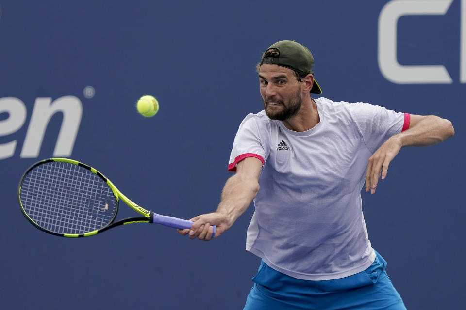 Maxime Cressy, of the United States, returns a shot to Pablo Carreno Busta, of Spain, during the first round of the US Open tennis championships, Tuesday, Aug. 31, 2021, in New York. (AP Photo/Seth Wenig)