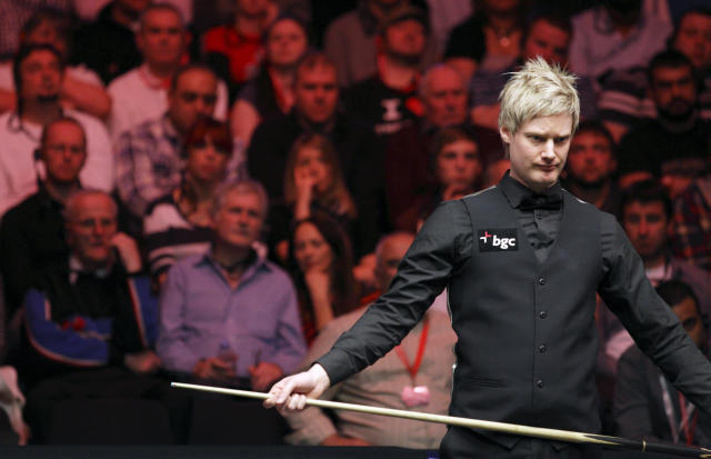 Australia's Neil Robertson lines up a shot during a frame against Shaun Murphy of England during the final of the BGC masters snooker tournament at Alexandra Palace in London, on January 22, 2012. AFP PHOTO / JUSTIN TALLIS (Photo credit should read JUSTIN TALLIS/AFP/Getty Images)