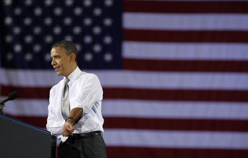 President Barack Obama rolls up his sleeves as he speaks at a campaign fundraiser at the University of Vermont in Burlington, Vt., Friday, March, 30, 2012. (AP Photo/Pablo Martinez Monsivais)