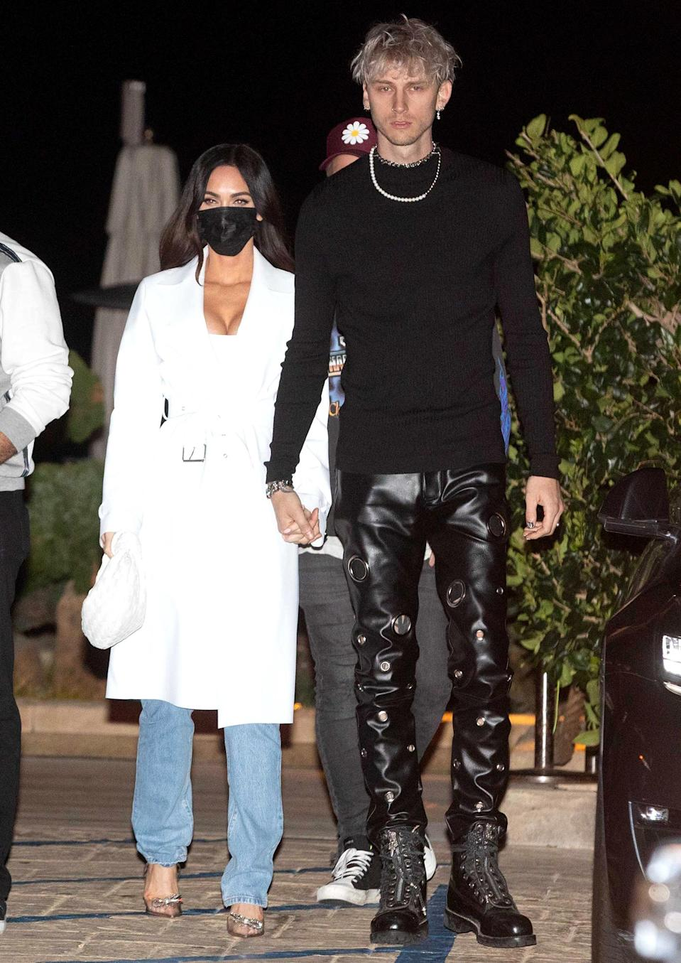 <p>Megan Fox and Machine Gun Kelly hold hands after dinner at Nobu in Malibu, California, over the weekend.</p>