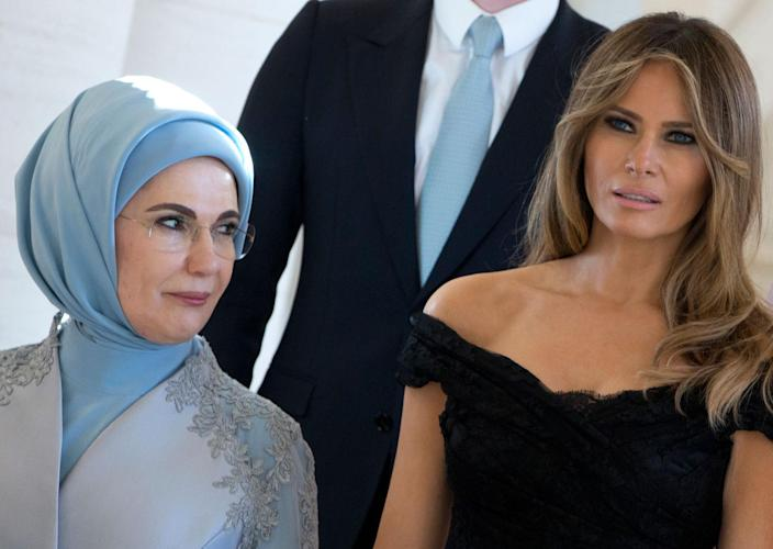 <p>Melania Trump, the wife of US President Donald Trump, right, and Emine Erdogan, the wife of Turkish President Recep Tayyip Erdogan pose together during a group photo during the spouse and partner program at the Royal Palace of Laeken, near Brussels, on Thursday, May 25, 2017. (Photo: Virginia Mayo/AP) </p>
