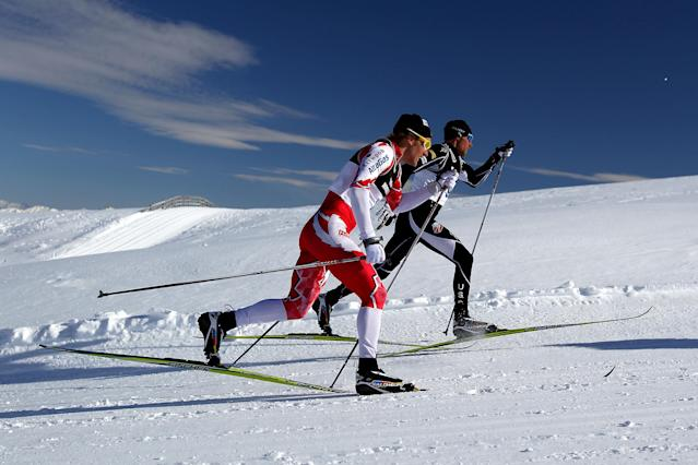 WANAKA, NEW ZEALAND - AUGUST 13: Devon Kershaw of Canada and Andrew Newell of the United States compete in the Cross Country Men's 10km Mass Start during day one of the Winter Games NZ at Snow Farm on August 13, 2011 in Wanaka, New Zealand. (Photo by Hannah Johnston/Getty Images)