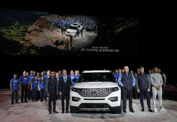 PHOTO: Ford executives and the Ford Explorer team pose with the all-new 2020 Ford Explorer SUV at its reveal, Jan. 9, 2019, in Detroit. (Bill Pugliano/Getty Images)