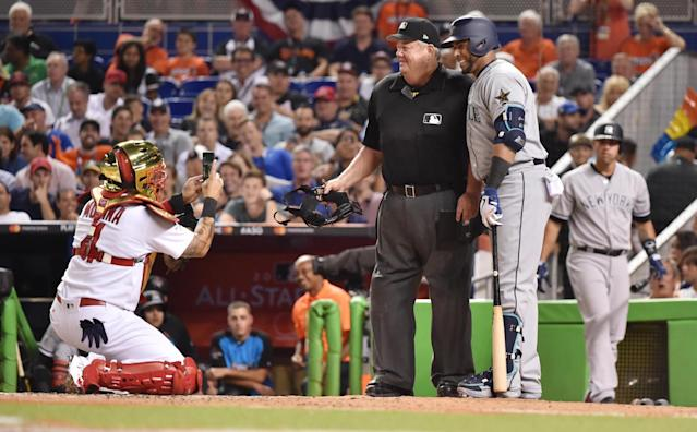 <p>National League catcher Yadier Molina (4) of the St. Louis Cardinals takes a photo of American League player Nelson Cruz (23) of the Seattle Mariners with umpire Joe West in the sixth inning during the 2017 MLB All-Star Game at Marlins Park. (Steve Mitchell-USA TODAY Sports) </p>
