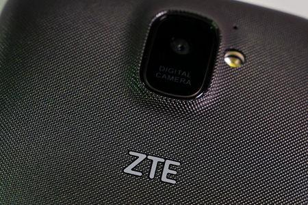 FILE PHOTO: A ZTE smart phone is pictured in this illustration taken April 17, 2018.  REUTERS/Carlo Allegri/Illustration/File Photo