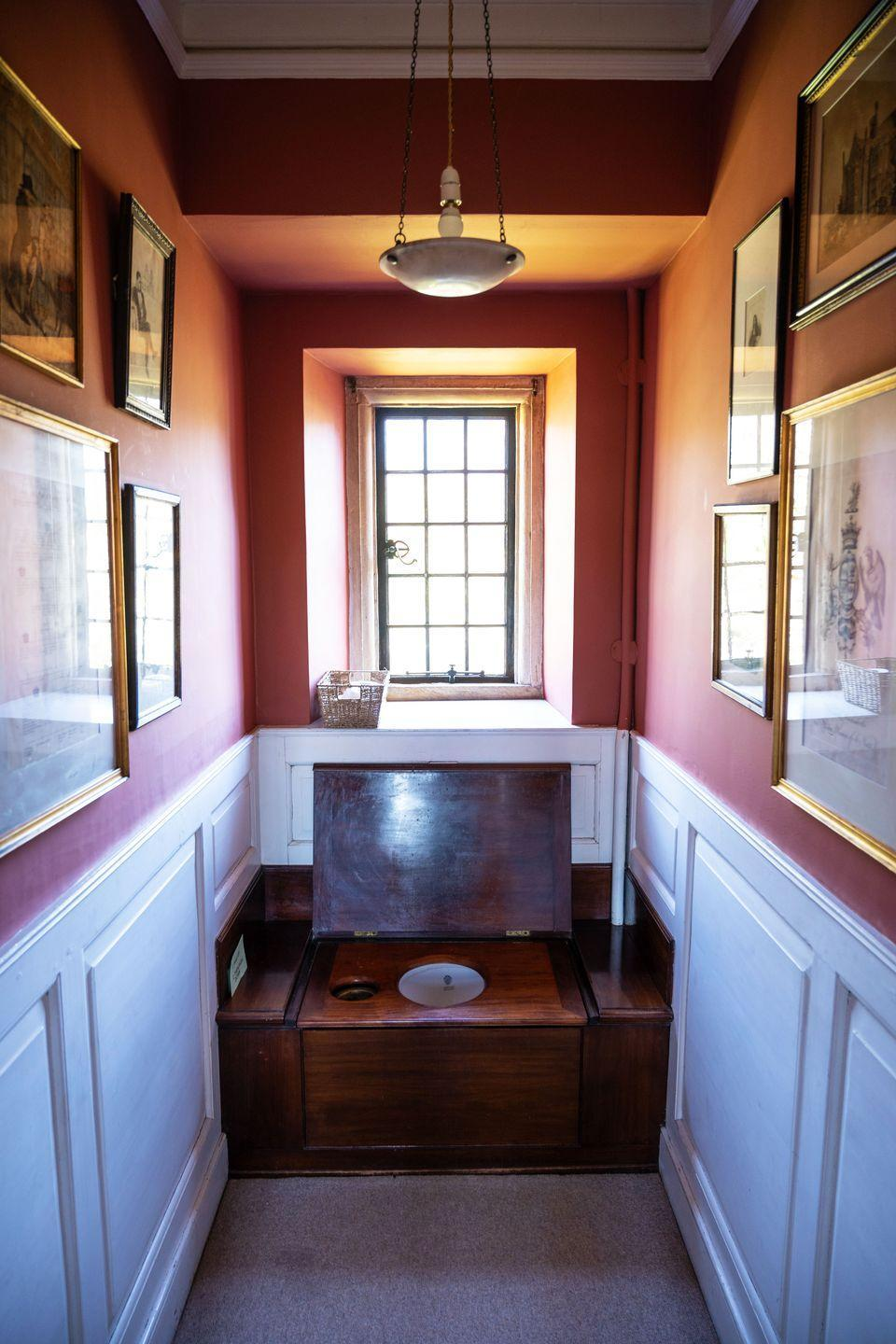 """<p>""""This is a favourite room; it's full of political cartoons satirising my husband's forebears. The lavatory is equally titillating; it's over 100 years old and has an unforgettable flush.""""</p>"""