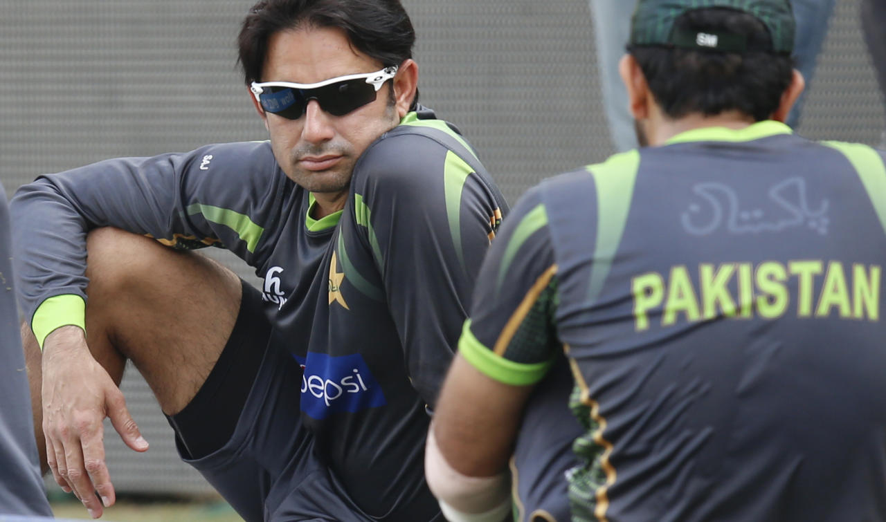 Pakistan's Saeed Ajmal, left, takes a break during a training session ahead of their ICC Twenty20 Cricket World Cup match against India in Dhaka, Bangladesh, Thursday, March 20, 2014. (AP Photo/Aijaz Rahi)