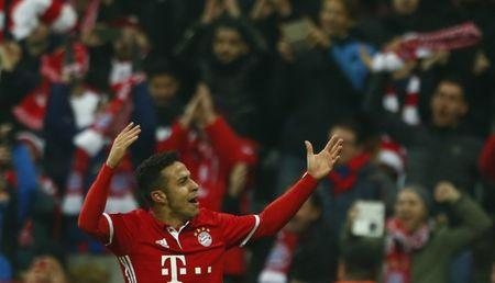 Football Soccer - Bayern Munich v Arsenal - UEFA Champions League Round of 16 First Leg - Allianz Arena, Munich, Germany - 15/2/17 Bayern Munich's Thiago Alcantara celebrates scoring their fourth goal  Reuters / Michaela Rehle Livepic