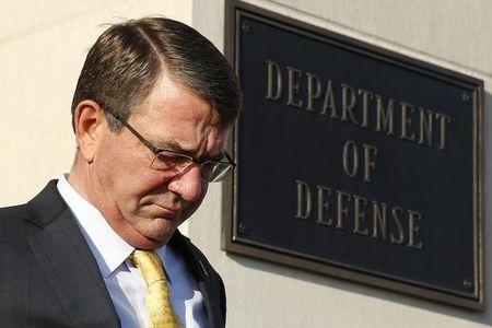 U.S. Secretary of Defense Ash Carter walks out from the Pentagon in Washington