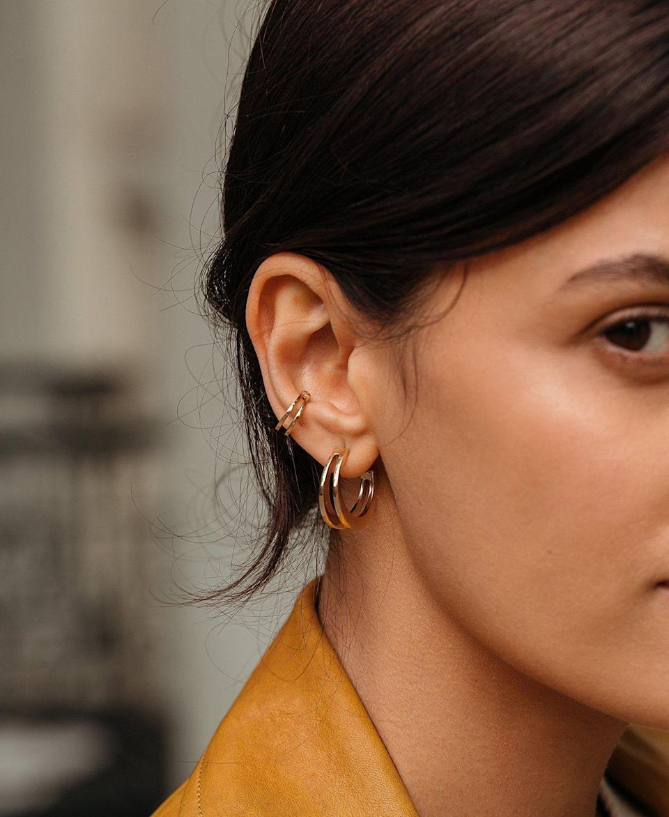 """Ear cuffs are great to gift because your giftee doesn't need piercings to wear them—and there are plenty of cute styles that don't break the bank. $50, Aurate. <a href=""""https://auratenewyork.com/products/lean-on-me-gold-ear-cuff"""" rel=""""nofollow noopener"""" target=""""_blank"""" data-ylk=""""slk:Get it now!"""" class=""""link rapid-noclick-resp"""">Get it now!</a>"""