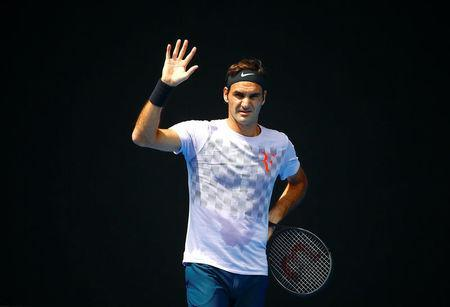 Tennis - Australian Open - Melbourne Park, Melbourne, Australia, January 10, 2018. Switzerland's Roger Federer waves to his playing partner during a practice session ahead of the Australian Open tennis tournament. REUTERS/David Gray