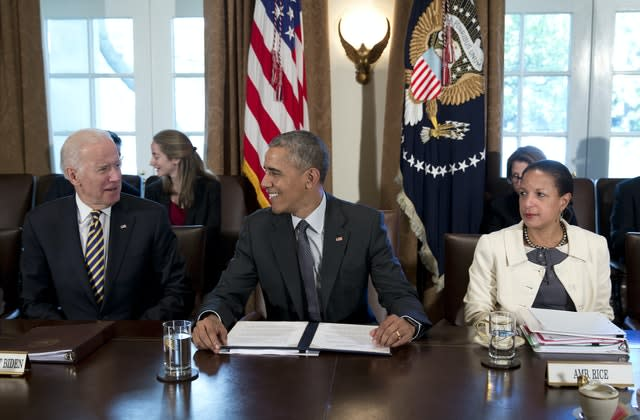Then president Barack Obama looks to then vice president Joe Biden, left, as then national security adviser Susan Rice, sits right (Carolyn Kaster/AP)
